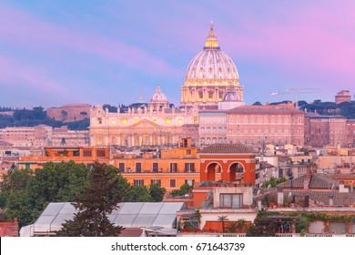 The view from the Pincian Hill overlooking St. Peter Basilica during beautiful sunset in Rome, Italy