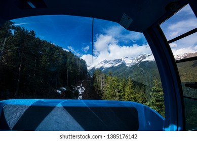 View of the Pirin Mountains as seen from inside a Gondola Lift enroute from the town of Bansko to Bansko Ski Resort.