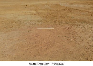 A view of the pitchers mound on the baseball dirt infield.
