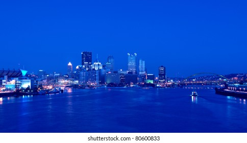 A view of Pittsburgh; Pennsylvania's skyline at night overlooking the Allegheny, Monongahela, and Ohio Rivers; Fort Pitt Bridge; Fort Duquesne Bridge; and Point State Park. HDR from five exposures.