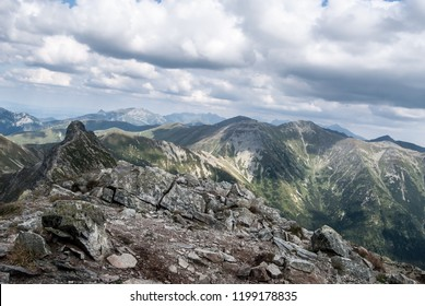 view from Placlive mountain peak on Rohace mountain group in Zapadne Tatry mountains in Slovakia with nearest sharp Ostry Rohac peak and many other peaks of Zapadne and Vysoke Tatry mountains
