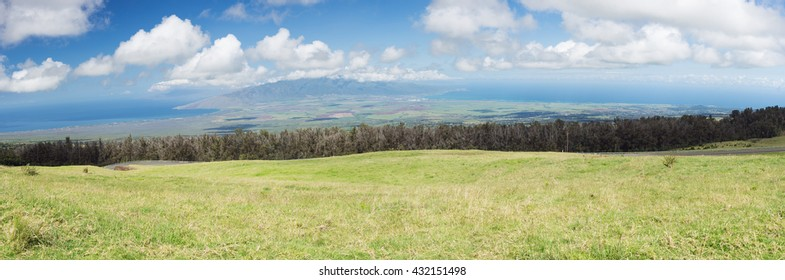 View of the plain between Kahului and Maalaea Bay seen from the lower slopes of Haleakala. The plain divides Maui in two.