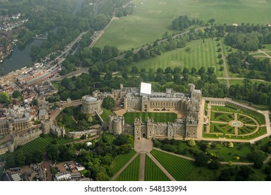 View from a plane of the historic Windsor Castle, home of Queen Elizabeth II in Royal Berkshire.  The River Thames passes to the left hand side and castle grounds stretch to the edge of the image.