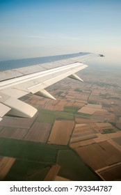 View from the plane to the islands and colorful fields