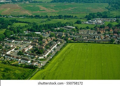 View from a plane of part of the village of Colnbrook, Berkshire on a sunny morning in June.