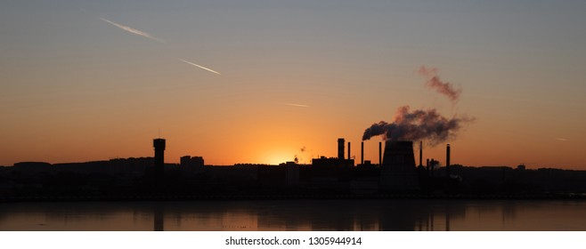 View of the plant with pipes. Atmospheric pollution by industrial emissions. Environmental problems