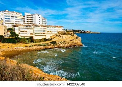 view of the Platja dels Llenguadets cove and the northern coastline of Salou, surrounded by the Cami de Ronda, a walk bordering the ocean, in this famous summer destination in the Costa Dorada, Spain