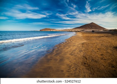 view of Playa el Medano beach with Montana Roja mountain on the background, Tenerife, Canary islands, Spain
