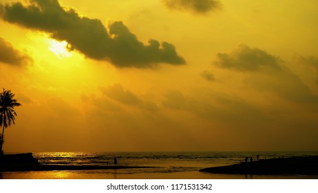 View of poeple in sunset on the beach background