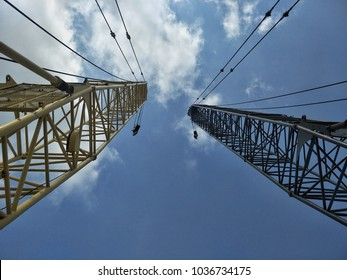 View point from bottom to the sky.  See two boom of crawler crane high to sky. suitable for artwork.