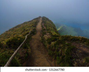 View point Miradouro da Boca do Inferno overlooking the lakes of Sete Cidades, lakes covered by fog mist and clouds. Sao Miguel in the Azores, Portugal