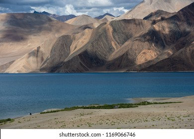 View point at Pangong Lake with blue and turquoise water, Himalaya mountain, sky and cloud background in summer