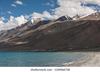 View point at Pangong Lake with blue and turquoise water, camps, Himalaya mountain, sky and cloud background in summer