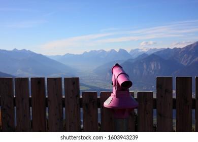 view point at Patscherkofel over Innsbruck with pink binocular