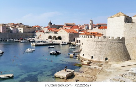 View from view point showing city wall, sea, port and boat at Dubrovnik, Croatia