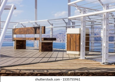 view point terrace white pipes frame and wooden deck floor with bench for sitting landscaping urban object