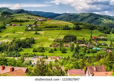 View of Polish town Rytro from Beskidy Mountains (Beskid Sadecki). Beskid Sadecki is a part of Karpaty (Carpathian mountains). Europe