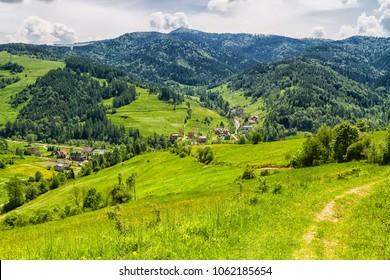 View of Polish town Wierchomla from Beskidy Mountains (Beskid Sadecki). Beskid Sadecki is a part of Karpaty (Carpathian mountains). Europe