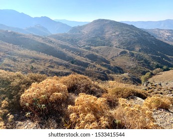 View from Polyrrinia, Kissamos region, Crete, Greece - Mediterranean mountain landscape with rolling brown terrain and golden foliage in mid-October