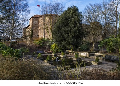 A view of a pond in Colchester Castle Park with the magnificent Colchester Castle in the background, in Colchester, UK.