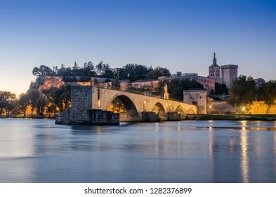 a view of the Pont d'Avignon or Benezet bridge and Palais des Papes of Avignon France