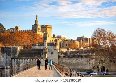 view of Pont Saint-Bénezet(Pont d'Avignon) and the medieval castle/walls in Avignon, France. Pont Saint-Bénezet is famous for its history and the broken part in the river.