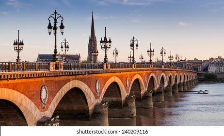 View of the Pont de pierre at sunset in the famous winery region Bordeaux, France - Shutterstock ID 240209116