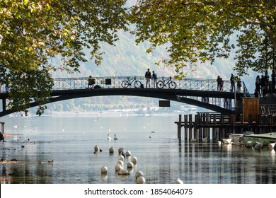 View of the Pont des Amours (Love Bridge) in the city of Annecy, in Haute-Savoie, France. In the background, there is the famous lake.