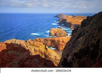 View of the Ponta de São Lourenço lighthouse. Dramatic cliffs, blue ocean, cloudy sky. hiking on Ponta de São Lourenço, Madeira Island.