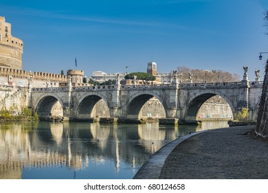 A view of Ponte Sant'Angelo (Bridge of Hadrian) on Tiber river in front of Castel Sant'Angelo (Castle of the Holy Angel)  in Parco Adriano, Rome, Italy