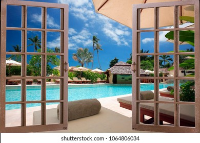 View of the pool through the window of the dirty room
