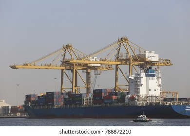 View of the port of Dakar in Senegal. Big ships and cranes can been seen near the quay. The cargos are used for transportation of heavy containers. The picture has been taken on 21st november 2015.