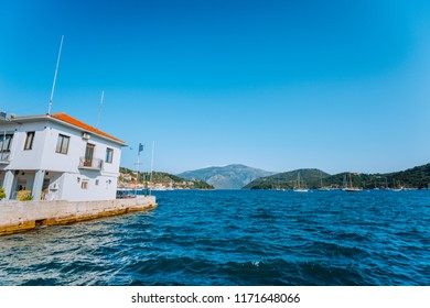 View of the port with fishing and sailing boats and the mountains that surround the port of vathy on the Ionian island of Ithaca, Greece