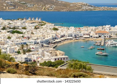 View of the port of Mykonos Town on the sea in Mykonos, Greece from a hilltop