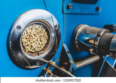 View of porthole preview window of roasting coffee machine on industrial manufacture