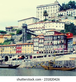 "View of Porto city at the riverbank (Ribeira quarter) and wine boats(""Rabelo"") on River Douro(Portugal), a UNESCO World Heritage City. Square toned image, instagram effect"