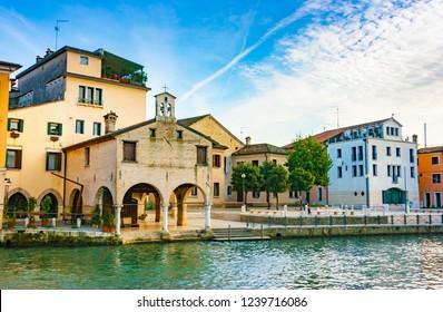 View of Portogruaro with lemene river and Oratorio Madonna della Pescheria, Portogruaro, Veneto, Italy