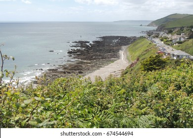 A view of Portwrinkle and the hotel from the coast path and golf course, looking west towards Looe in Cornwall