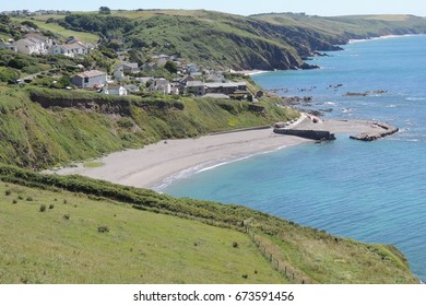 A view of Portwrinkle village, harbour and beach, from the coast path between Looe in Cornwall and Plymouth in Devon