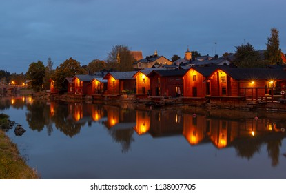 View of Porvoo old town at night with red wooden sheds  situated on the southern coast of Finland