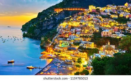View of Positano village along Amalfi Coast in Italy at dusk.