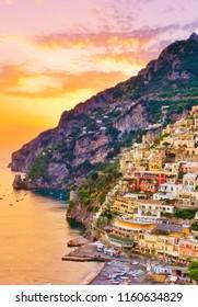View of Positano village along Amalfi Coast in Italy at sunset.