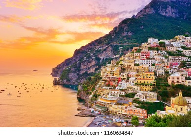 View of Positano village along Amalfi Coast in Italy at sunset.