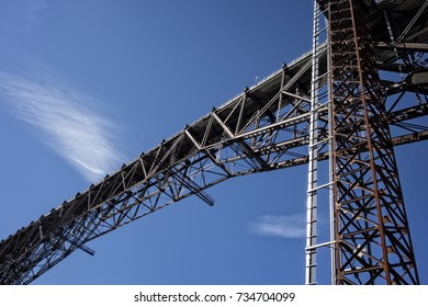 A view of the Poughkeepsie Bridge, known as the Walkway Over the Hudson, details the bridge architecture and includes the shaft of the glass elevator that takes visitors to the top.