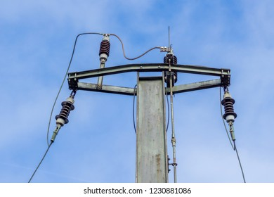 View of Power Lines in front of a clear blue Sky.