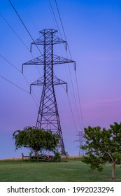 A view of power lines in the light of the setting sun.