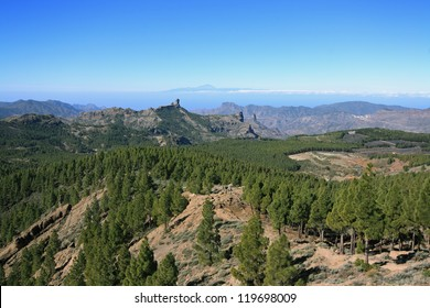 View from Pozo de las Nieves, Gran Canaria, Canary Islands. In the background the characteristic rock Roque Nublo in the front of distant Island of Tenerife with the volcanic peak of Pico del Teide.