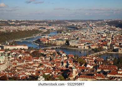 View of Prague and the bridges with the river, from one of the tops, in a sunny day during the autumn time, Czech Republic