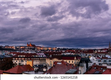 View of Prague with Prague Castle in the background from Vysehrad in the evening with dramatic clouds. Rooftops. Prague. Czech Republic.