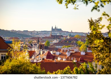 View of Prague Castle over red roof from Vysehrad area at sunset lights, Prague in Czech Republic